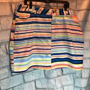 Woman within pretty striped skirt. Size 20W